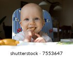 baby girl eating bisquit | Shutterstock . vector #7553647