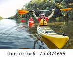 man paddling in a kayak on... | Shutterstock . vector #755374699