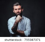 a man with tattoo on arm... | Shutterstock . vector #755387371