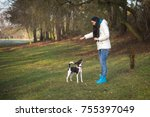 young woman trains the dog in... | Shutterstock . vector #755397049