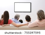 family and blank tv display at... | Shutterstock . vector #755397595