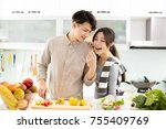 happy young couple cooking in... | Shutterstock . vector #755409769