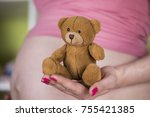 teddy bear toy  pregnant woman | Shutterstock . vector #755421385