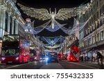 red double decker buses pass... | Shutterstock . vector #755432335