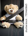 Small photo of Belted Teddy in the car symbolizes importance of strapping on