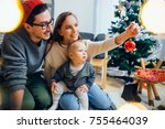 happy family and little son... | Shutterstock . vector #755464039