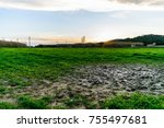 wet mud puddle in field and... | Shutterstock . vector #755497681
