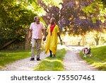 Stock photo senior couple walking with pet bulldog in countryside 755507461