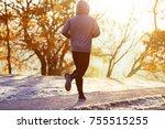 man jogging on sunny autumn... | Shutterstock . vector #755515255