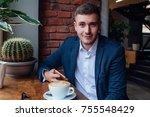 the boyfriend in a suit sitting ... | Shutterstock . vector #755548429