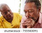 Small photo of Senior Woman Comforting Man With Depression At Home