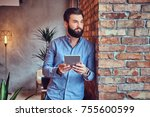 a man using tablet pc in a room. | Shutterstock . vector #755600599