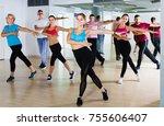 men and ladies dancing aerobics ... | Shutterstock . vector #755606407