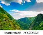 mountains clouds and sun | Shutterstock . vector #755616061