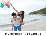 sweet couple travel on the beach | Shutterstock . vector #755628571