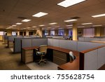 Small photo of An empty office space with furnished cubicles ready to be occupied.