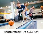 friends bowling at club | Shutterstock . vector #755661724