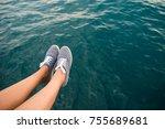 woman legs hang from the pier | Shutterstock . vector #755689681