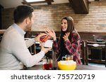a happy couple is having fun at ... | Shutterstock . vector #755720719