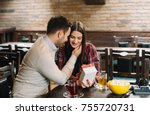 a happy couple is having fun at ... | Shutterstock . vector #755720731