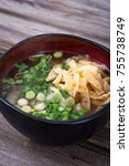 asian soup topped with wonton...