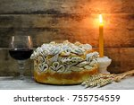 Small photo of Homemade decorated Serbian slava bread with red wine