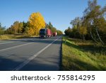 truck and a small truck driving ... | Shutterstock . vector #755814295