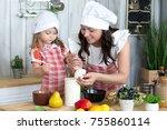 mother and daughter cook dinner ... | Shutterstock . vector #755860114