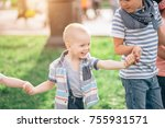 laughing boy holding hands... | Shutterstock . vector #755931571