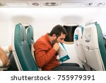 airsickness. man feels very... | Shutterstock . vector #755979391