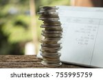 Small photo of stack of coins with pass book,account book,money saving concept