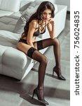seductive girl posing in black... | Shutterstock . vector #756024835