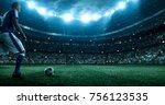 soccer player kicks the ball on ... | Shutterstock . vector #756123535