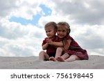 cute elder sister soothing her... | Shutterstock . vector #756198445