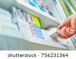Closeup Pharmacist Hand Holdin...