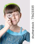 the girl  looks through a... | Shutterstock . vector #75623335