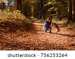 Stock photo young beautiful woman walking with a beagle in the park autumn sunny day 756253264