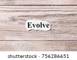 Small photo of EVOLVE of the word on paper. concept. Words of EVOLVE on a wooden background.