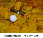 a golf ball and putter on the... | Shutterstock . vector #756294325