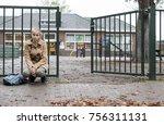 sad girl sitting alone at... | Shutterstock . vector #756311131