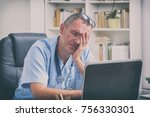 overworked doctor sitting in... | Shutterstock . vector #756330301