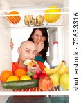 young couple eating and looking ... | Shutterstock . vector #75633316