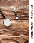 stethoscope on wood background | Shutterstock . vector #756348955