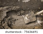 Concreting in progress with shovel. Background - stock photo