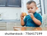 baby in the kitchen eagerly... | Shutterstock . vector #756417199