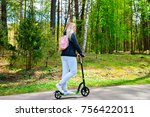 young woman on push scooter in... | Shutterstock . vector #756422011