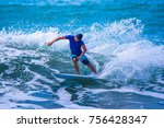 riding the waves. costa rica ... | Shutterstock . vector #756428347