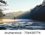 The morning fog finally lifting around the ruins of Jones Bridge on the Chattahoochee River.