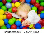the baby is playing in colored... | Shutterstock . vector #756447565