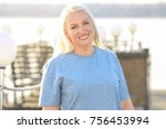 happy mature woman outdoors | Shutterstock . vector #756453994
